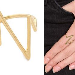 """Inspired by the waves on a heart rate monitor, this <b>Sarah Chloe Large Heartbeat Ring</b> will show her the pitter-patter of your love. This stylish gold-plated ring is cool departure from usual heart-motif. Available for $98 at <a href=""""http://www.shop"""