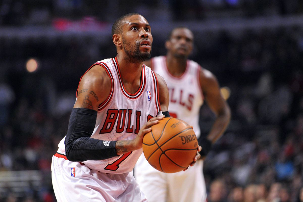 Mar 26, 2012; Chicago, IL, USA;  Chicago Bulls point guard C.J. Watson (7) shoots a free throw against the Denver Nuggets during the first half at the United Center.  Mandatory Credit: Mike DiNovo-US PRESSWIRE