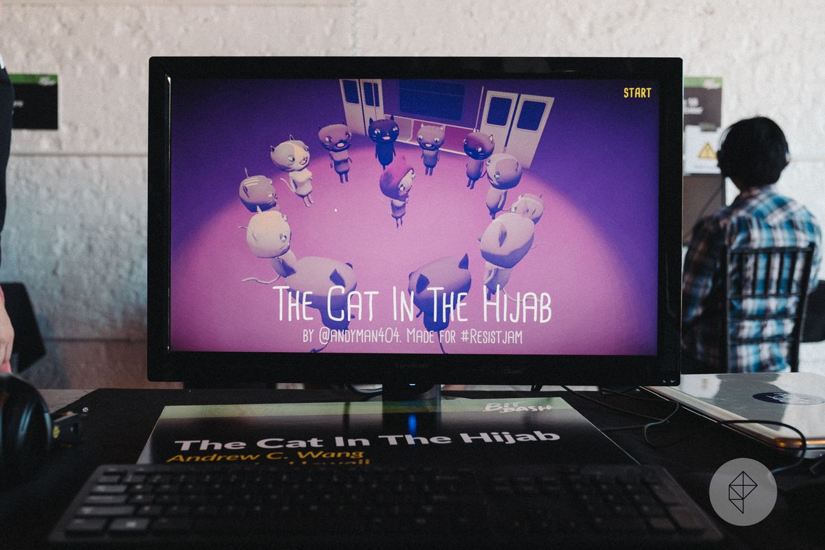 A monitor displays the start screen for The Cat In The Hijab.