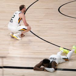 Utah Jazz's Joe Ingles (2) and Donovan Mitchell, bottom right, sit on the floor after their 80-78 loss to the Denver Nuggets during an NBA first round playoff basketball game, Tuesday, Sept. 1, 2020, in Lake Buena Vista, Fla.