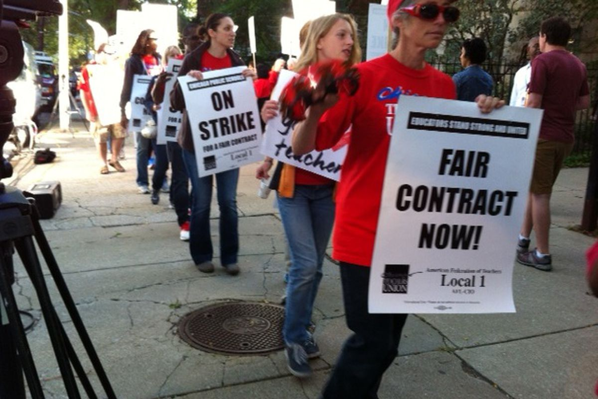 Chicago Teachers Union  members picketed in 2012 outside Ray Elementary School, the school that  then-U.S. Education Secretary Arne Duncan's children once attended.