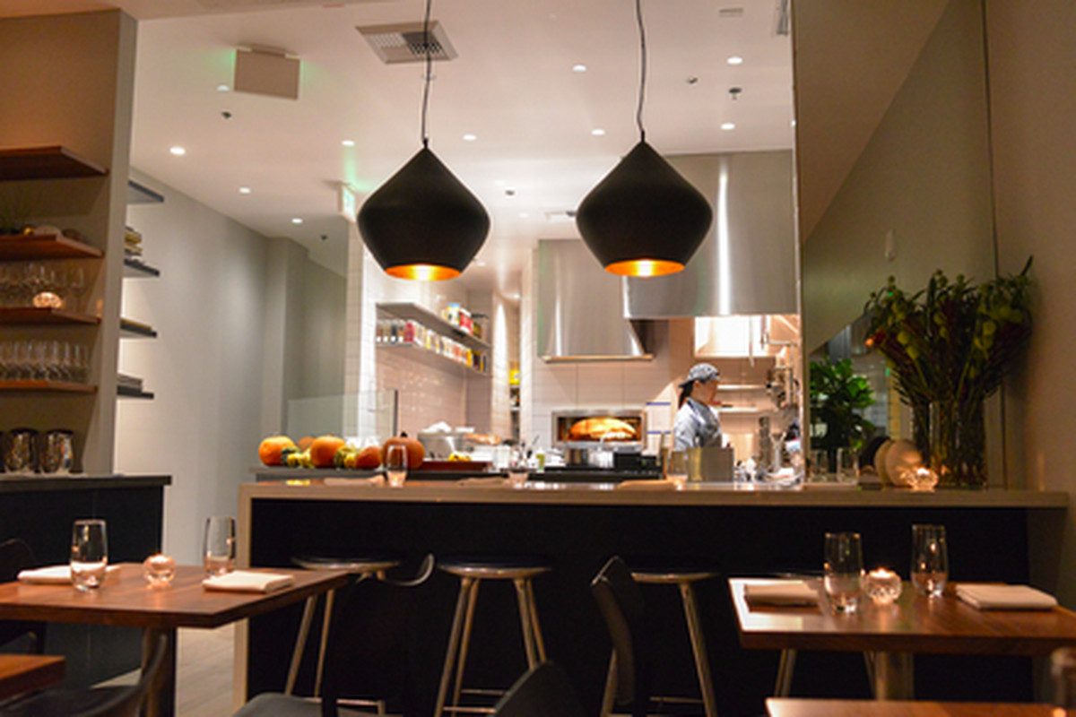 Orsa & Winston dining room looking into the kitchen in Downtown LA.