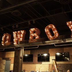 Cowboy lights above one of the bars.