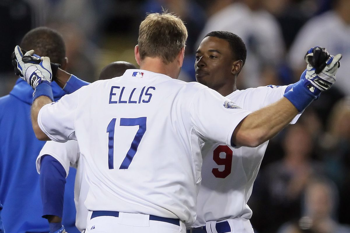 A.J. Ellis and Dee Gordon enjoy the dance of first place.