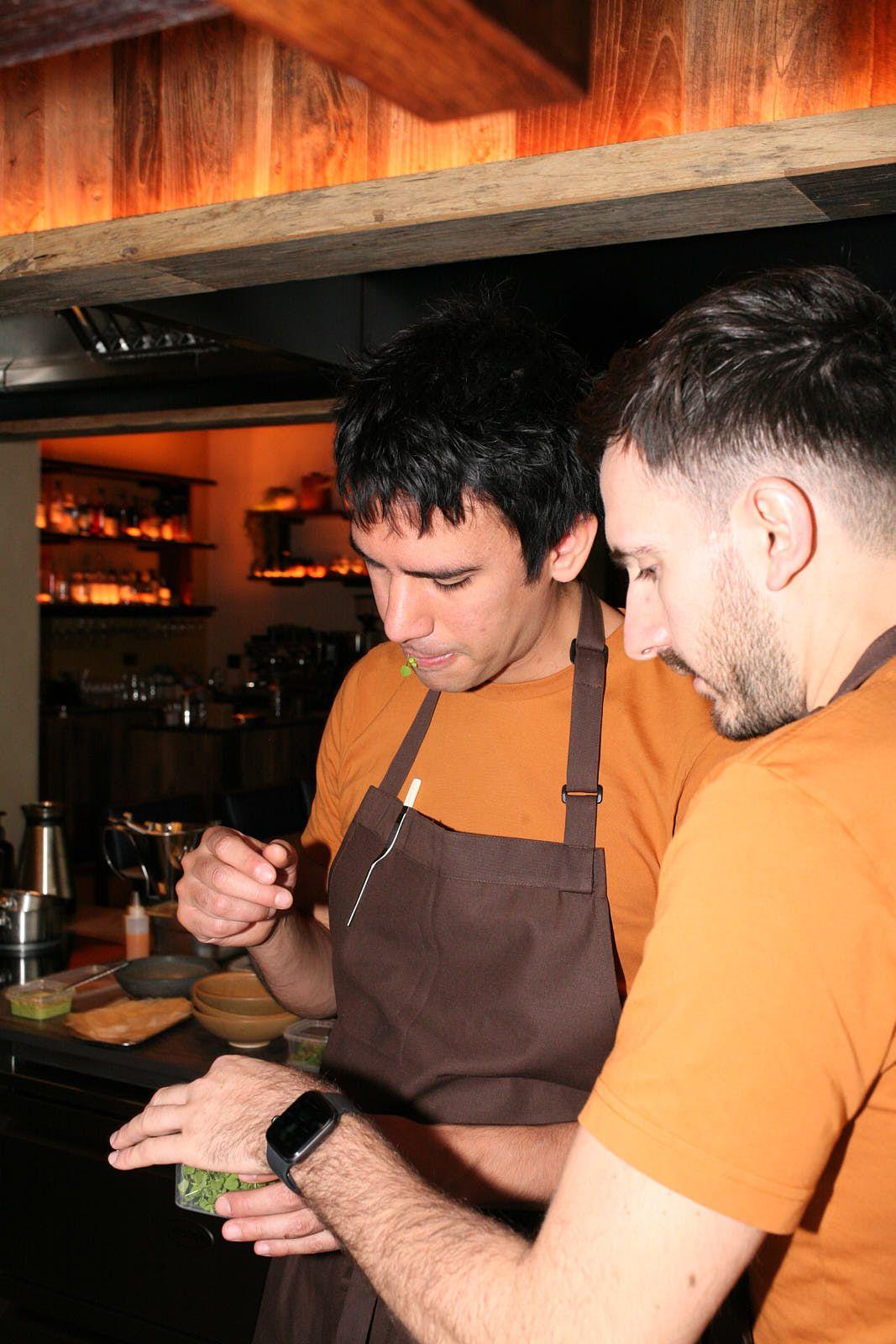 Santiago Lastra tastes a micro herb with Kol head chef, Ben Morgan