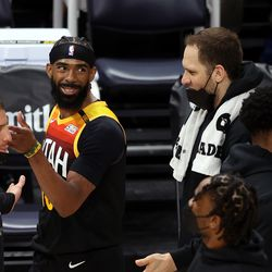 Utah Jazz guard Mike Conley (10) smiles as he and teammate Utah Jazz forward Bojan Bogdanovic (44) talks during a timeout as the Utah Jazz and the Memphis Grizzlies play in game 5 at Vivint Arena in Salt Lake City on Wednesday, June 2, 2021.