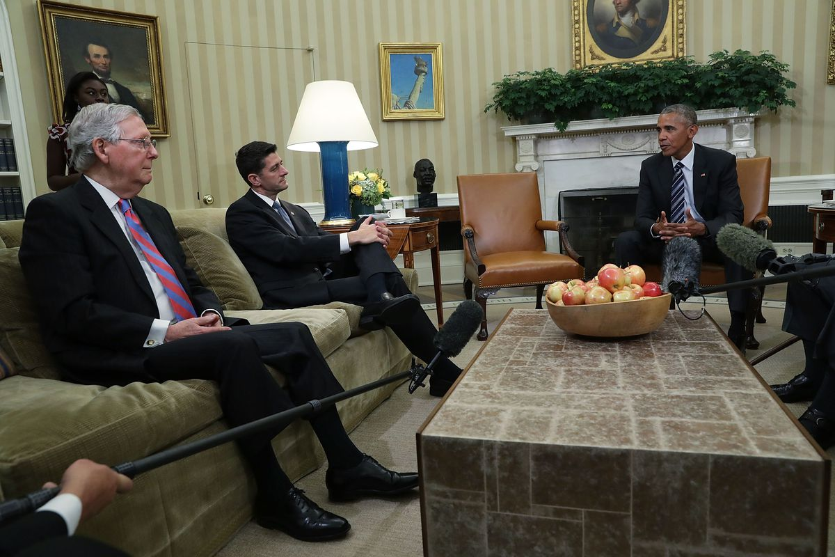 Sen. Mitch McConnell (R-KY), left, and Rep. Paul Ryan (R-WI) listen to President Barack Obama during an Oval Office meeting at the White Housein 2016.