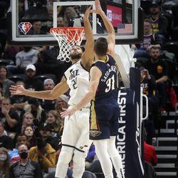 Utah Jazz center Rudy Gobert (27) reaches to block New Orleans Pelicans guard Tomas Satoransky's shot during a preseason NBA game at the Vivint Smart Home Arena in Salt Lake City on Monday, Oct. 11, 2021.