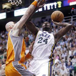 Utah Jazz forward Paul Millsap (24) pushes up a shot over Phoenix Suns center Marcin Gortat (4) as the Utah Jazz and the Phoenix Suns play Tuesday, April 24, 2012 in Energy Solutions arena.