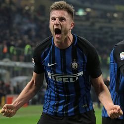 Milan Skriniar of FC Internazionale Milano celebrates after scoring the opening goal during the serie A match between FC Internazionale and Benevento Calcio at Stadio Giuseppe Meazza on February 24, 2018 in Milan, Italy.