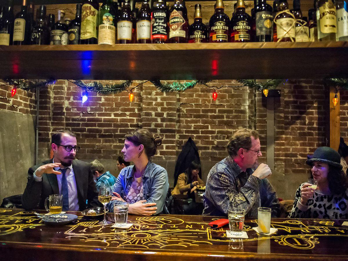 Patrons at the bar at Ticonderoga Club
