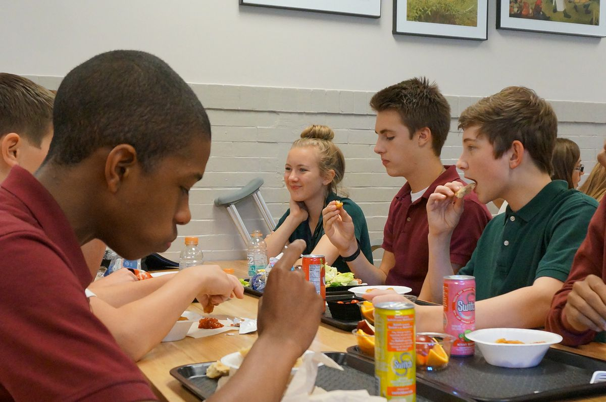 Students eat lunch at the Oaks Academy Middle School, a private Christian school in Indiana that is integrated by design and accepts taxpayer funded vouchers.
