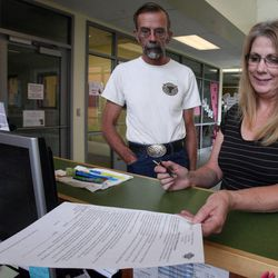Dave and Shaunie Larsen fill out paper work to adopt a dog at the West Valley City Animal Shelter in West Valley City on Saturday, Sept. 1, 2012.