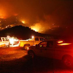 Authorities watch the fires progress from the top of Little Mountain.