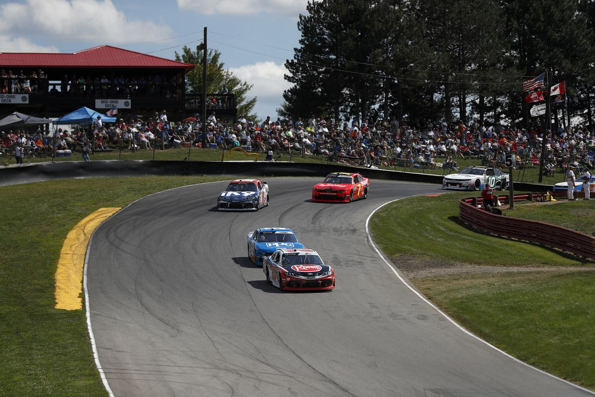 Christopher Bell, driver of the #20 Rheem Toyota, and Austin Cindric, driver of the #22 PPG Ford, come around the corner in the B&L Transport 170 at Mid-Ohio Sports Car Course on August 10, 2019 in Lexington, Ohio.
