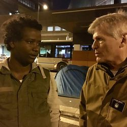 Elder Tom Herway, right, an LDS Church service missionary assisting in Italy with refugee projects and efforts, speaks with refugee Momo Hussein.