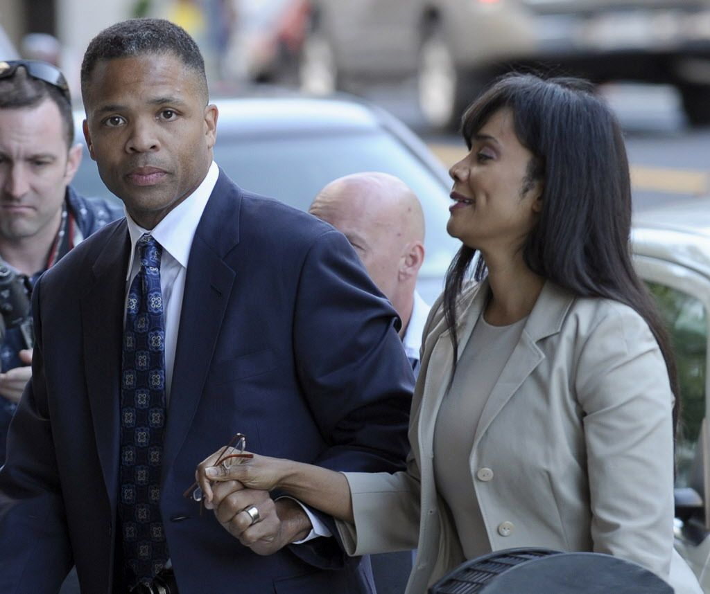 Former Rep. Jesse Jackson Jr. and his wife, Sandi, arrive at federal court in Washington in 2013 for their sentencing.   Susan Walsh/AP file photo