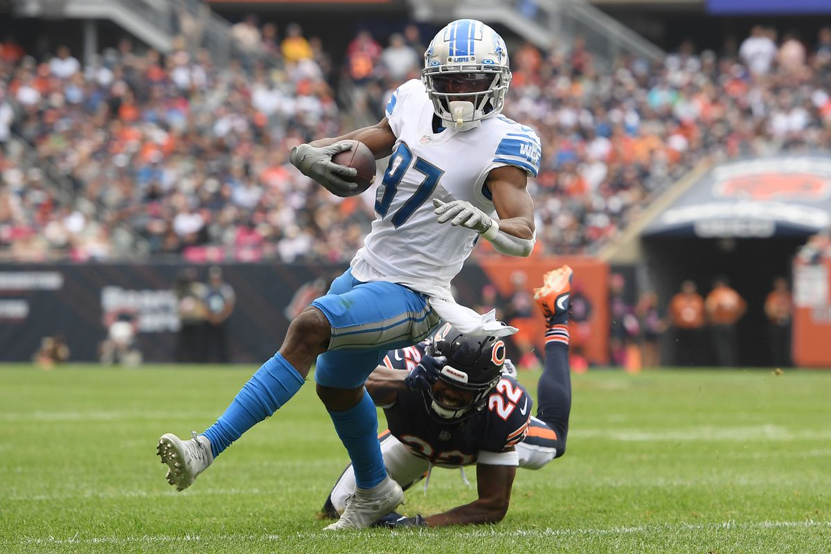 Detroit Lions wide receiver Quintez Cephus (87) runs for a first down in the second half against Chicago Bears cornerback Kindle Vildor (22) at Soldier Field.