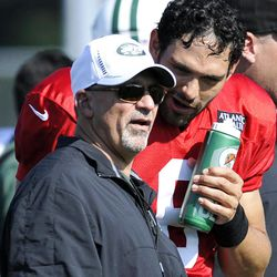 ADVANCE FOR WEEKEND OF EDITIONS OF SATURDAY, SEPT. 22 AND THEREAFTER - FILE - In this July 30, 2012, file photo, New York Jets quarterback Mark Sanchez, right, talks to offensive coordinator Tony Sparano, left, at NFL football training camp in Cortland, N.Y. Sparano, operating in the New York fishbowl, already has Jets fans grumbling after just two games as their offensive coordinator. Sparano and Miami Dolphins offensive coordinator Mike Sherman will match wits Sunday, Sept. 23, 2012, when the Dolphins face the Jets, with both teams at 1-1 and part of a four-way tie for the AFC East lead.