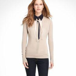 "<a href=""http://www.toryburch.com/MURPHY-SWEATER/11123120,default,pd.html?dwvar_11123120_color=074&start=13&cgid=sale"">Murphy sweater</a>, $147.50 (was $295)"