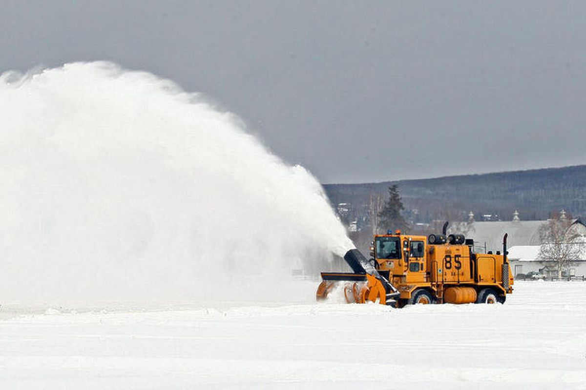 Department of Transportation workers from Fairbanks International Airport plow the fields at Creamer's Field Migratory Waterfowl Refuge Tuesday, April 3, 2012 in Fairbanks, Alaska as part of a cooperative management agreement between the airport, the Alas