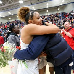 Judge Memorial's Teya Sidberry (32) hugs her father Tyrees Sidberry after defeating Grantsville in the 3A girls basketball semifinals at the Lifetime Activities Center in Taylorsville on Friday, Feb. 21, 2020.