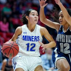 Bingham's Ameleya Angilau moves downcourt guarded by Copper Hills' Eleyana Tafisi in a 6A girls basketball semifinal game at the Huntsman Center in Salt Lake City on Friday, Feb. 28, 2020.