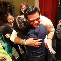 Classmates hug Siaosi Heimuli after a ceremony honoring him as Granite School District's Absolutely Incredible Kid at Granite Park Junior High in Salt Lake City on Monday, May 23, 2016.