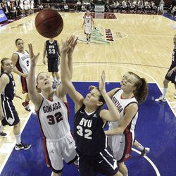 Brigham Young Cougars forward Dani Peterson (32) fights for the rebound with Gonzaga Bulldogs forward Kayla Standish (32)  in the West Coast Conference finals in Las Vegas  Monday, March 5, 2012.  BYU won the title and will advance to the NCAA tournament.