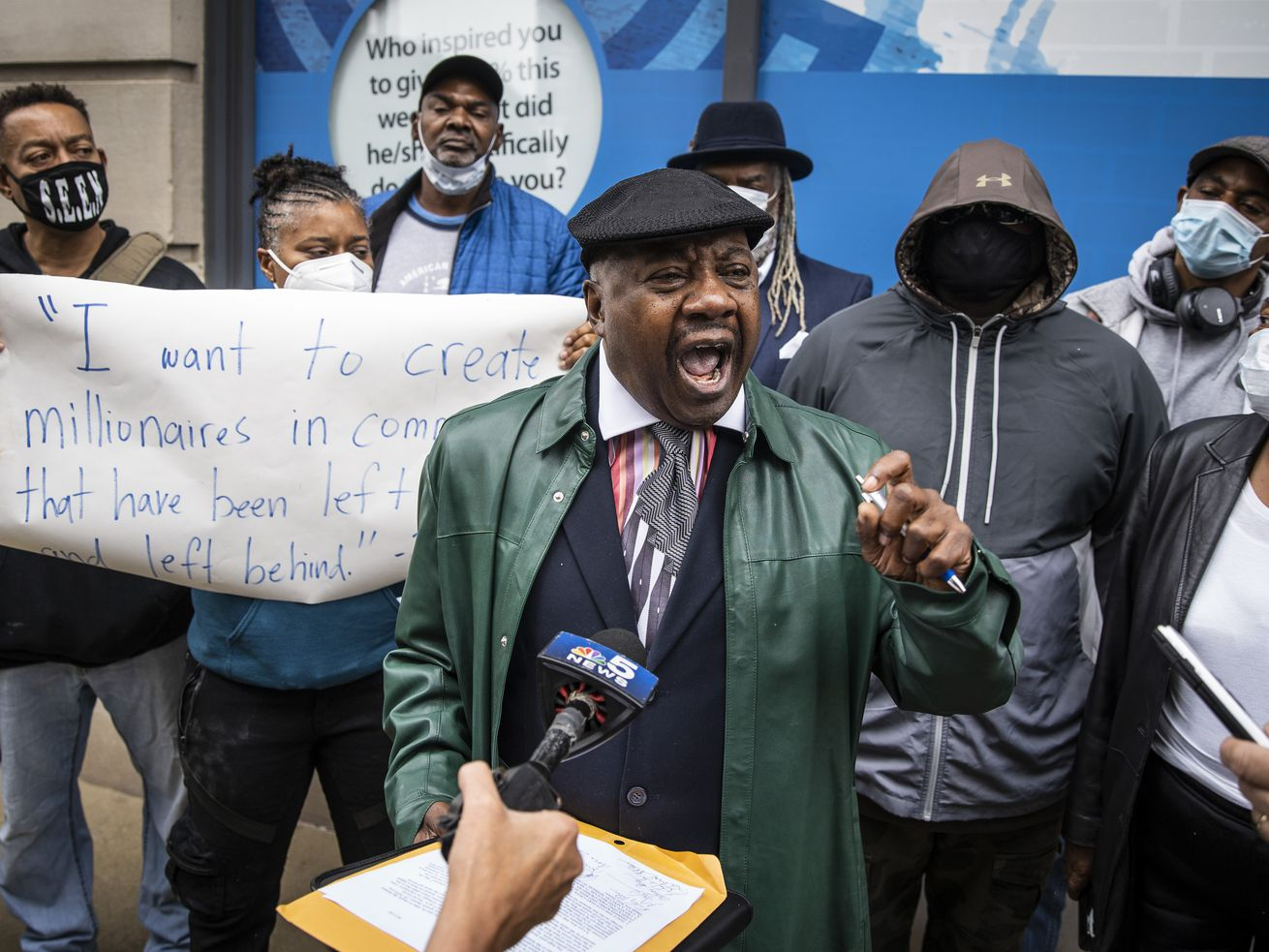 Former state Sen. Rickey Hendon protests in t the Loop — outside a building where Gov. J.B. Pritzker hosts an unrelated press conference — with Black and Latino social equity applicants who were denied for cannabis industry licenses in Illinois, Sept. 11, 2020. | Ashlee Rezin Garcia/Sun-Times