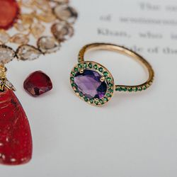 """This is my amethyst and tsavorite garnet <a href=""""https://catbirdnyc.com/shop/product.php?productid=19643&cat=0&page=1"""">Delilah ring</a> ($1,748) and also a red spinel that, judging by the way it's cut, was probably taken out of quite an old piece of jewe"""