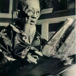 Reading a Chinese language newspaper in 1951.   Sun-Times Archives