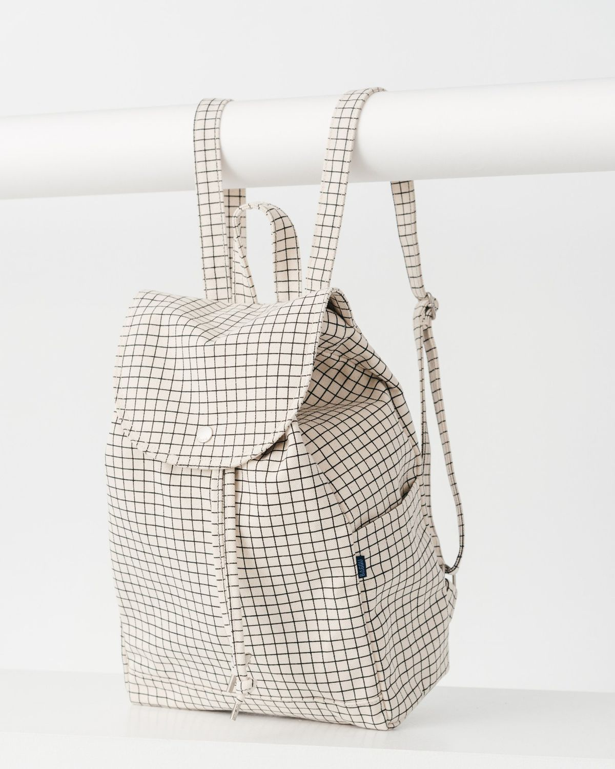 A drawstring backpack with a grid