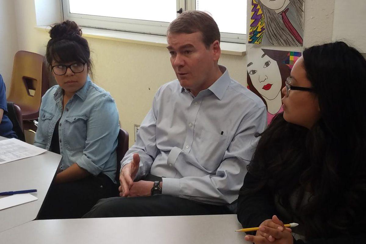 Michael Bennett speaks to high school seniors at Bruce Randolph School in 2017.
