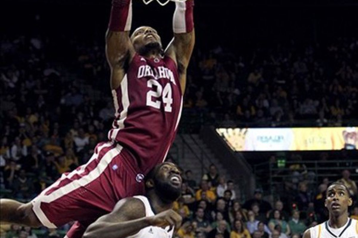 Feb 25, 2012; Waco, TX, USA; Oklahoma Sooners forward Romero Osby (24) takes a shot over Baylor Bears forward Quincy Acy (4) during the second half at the Ferrell Center.  Baylor won 70-60. Mandatory Credit: Kevin Jairaj-US PRESSWIRE