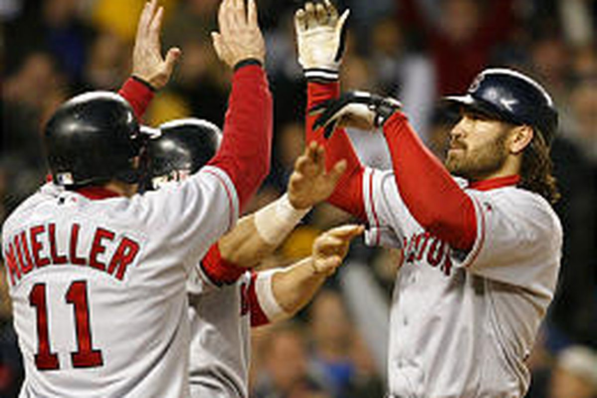 Boston Red Sox' Johnny Damon, right, celebrates with Bill Mueller after hitting a second-inning grand slam on Wednesday.