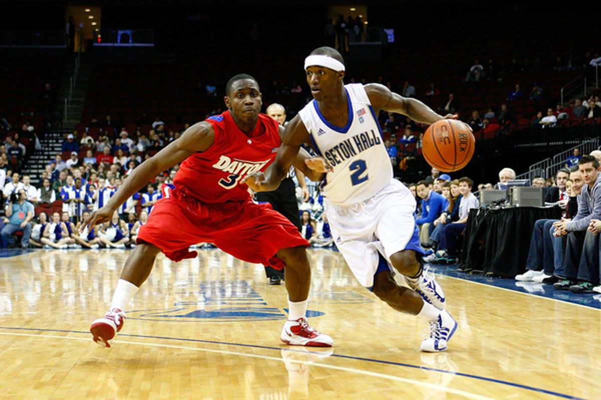 NEWARK NJ - DECEMBER 22:  Keon Lawerence #2 of the Seton Hall Pirates drives against Juwan Staten #3 of the Dayton Flyers at Prudential Center on December 22 2010 in Newark New Jersey.  (Photo by Chris Chambers/Getty Images)