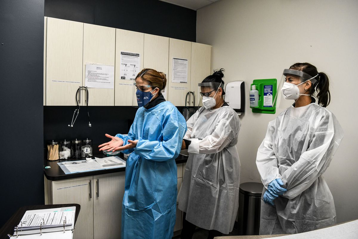 Workers prepare for medical examination of a volunteer for the COVID-19 vaccine study at the Research Centers of America in Hollywood, Florida, on August 13, 2020.