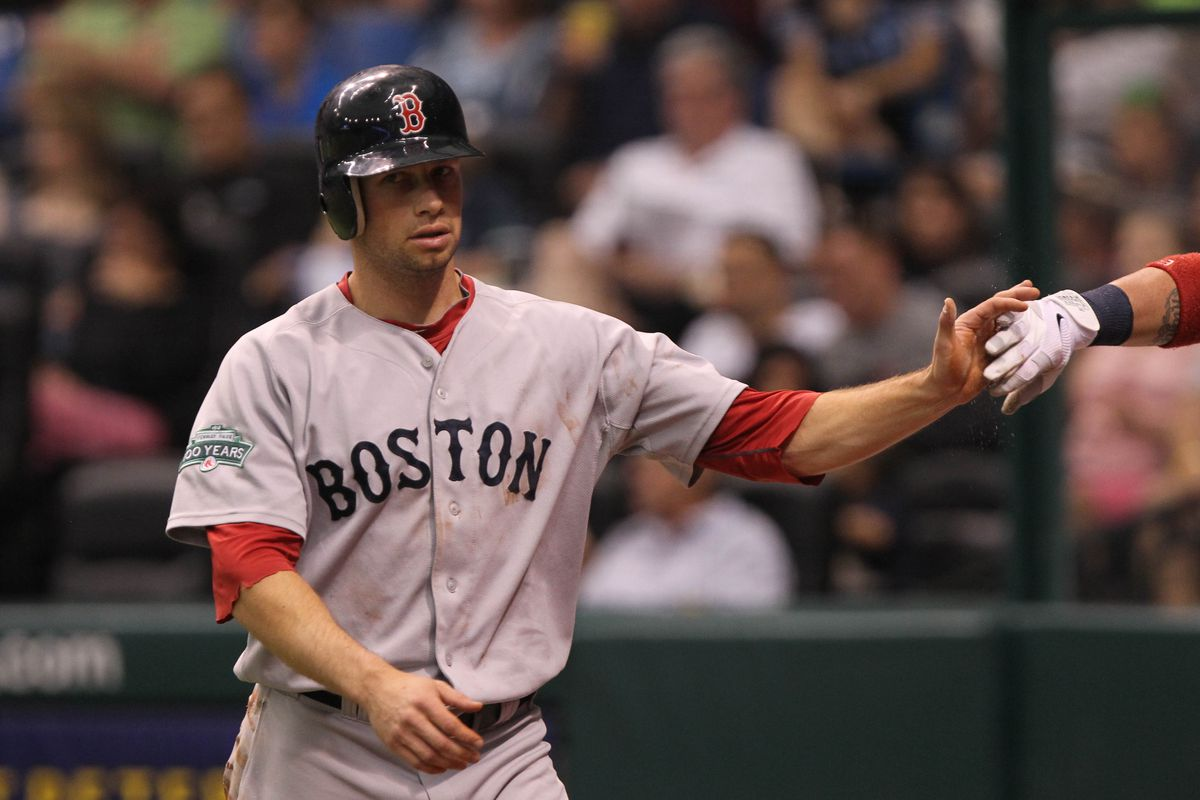 July 15, 2012; St. Petersburg, FL, USA; Boston Red Sox left fielder Daniel Nava (66) is congratulated by teammates after he scored a run in the first inning against the Tampa Bay Rays at Tropicana Field. Mandatory Credit: Kim Klement-US PRESSWIRE