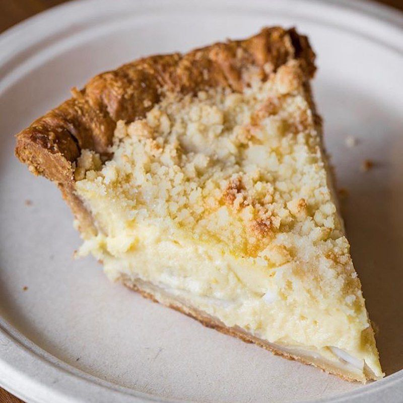 Slice of coconut pie on a plate.