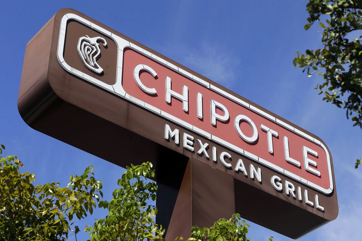 FILE - This Monday, Feb. 8, 2016, file photo shows the sign at a Chipotle restaurant. A state health official says a second person has tested positive for norovirus after eating at a Chipotle in Sterling, Va., before it was temporarily closed on Monday, J