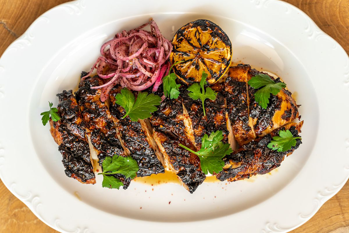 Charcoal-grilled Aleppo chicken served with sumac pickles