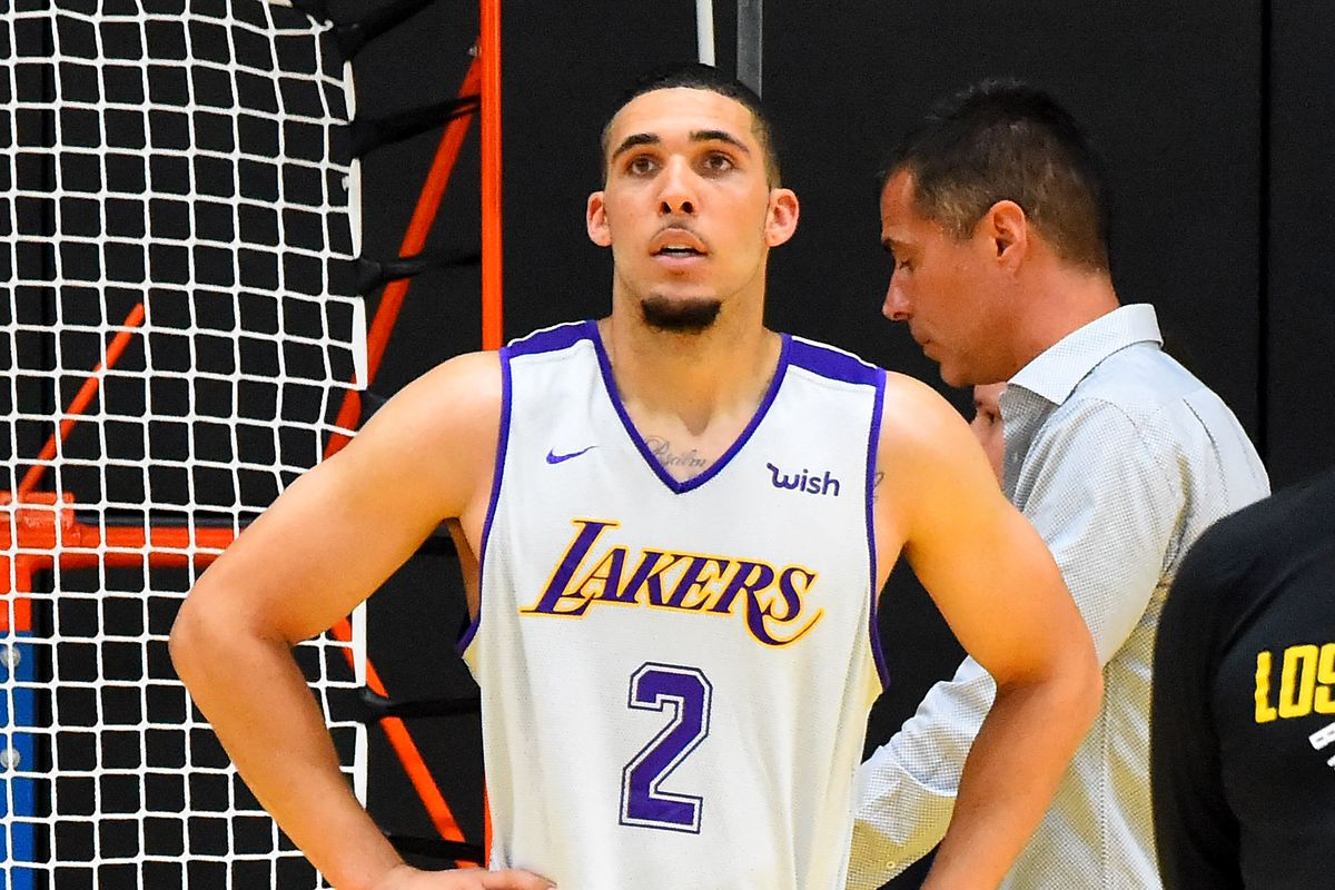 Rob Pelinka, General Manager of the Los Angeles Lakers, walks behind LiAngelo Ball during the Los Angeles Lakers 2018 NBA Pre-Draft Workout on May 29, 2018 in Los Angeles, California.