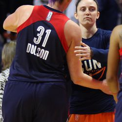 Connecticut Sun's Kelly Faris (34) embraces with her former teammate at UConn Stefanie Dolson (31).