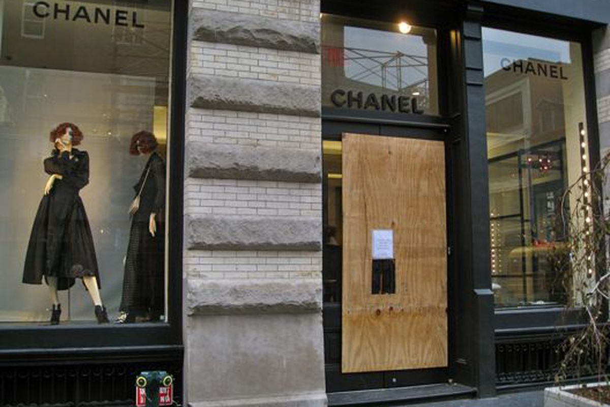 """Chanel <a href=""""http://ny.racked.com/archives/2010/01/26/chanel_hides_its_graffitiscarred_face_under_plywood.php"""">cleans up</a> after a graffiti hit in January"""