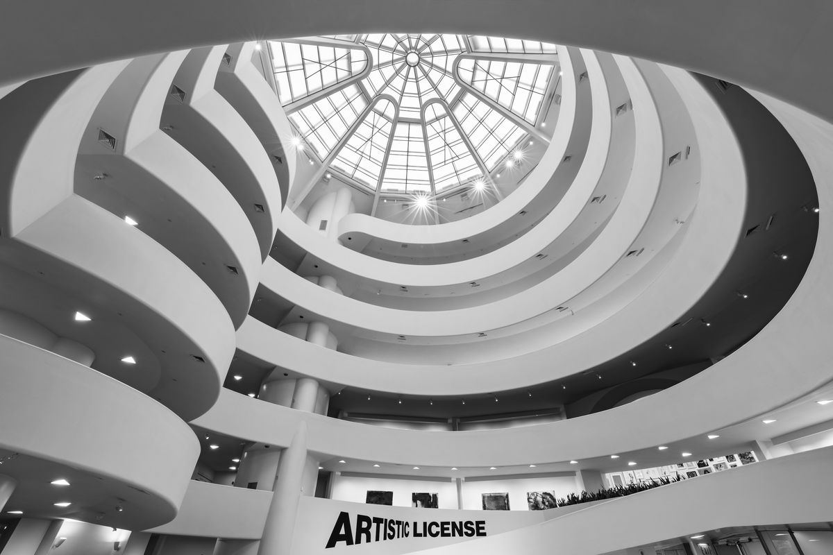 The interior of a museum building with a large spiral that takes up the entire space. It's topped with a large window.