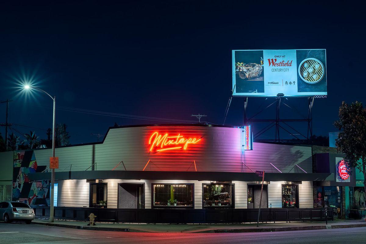 Mixtape's exterior neon sign corner location patio