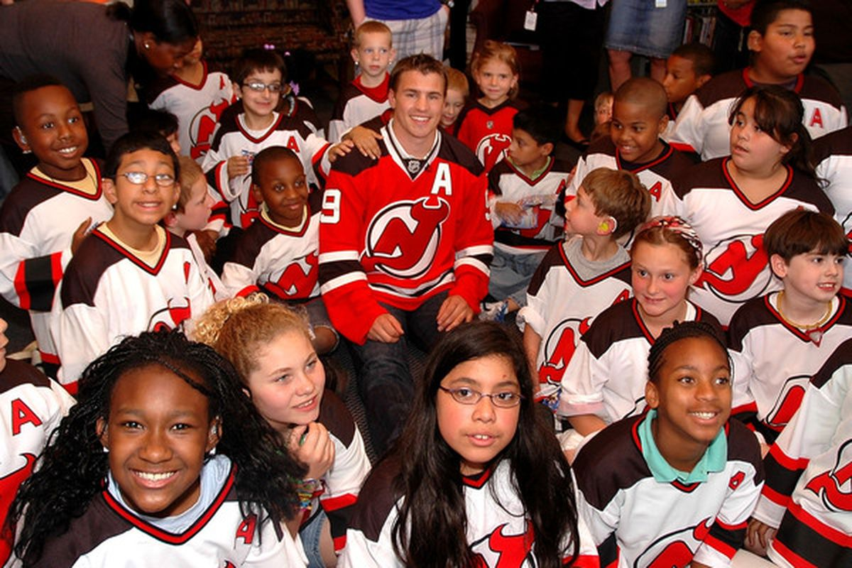 It wouldn't surprise me if all of these people here read In Lou We Trust. I know of at least one person in this photo does. (Photo by Andy Marlin/Getty Images for the New Jersey Devils)