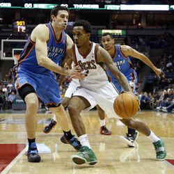 Milwaukee Bucks' Brandon Jennings, right, drives against Oklahoma City Thunders' Nick Collison, left, during the second half of an NBA basketball game Monday, April 9, 2012, in Milwaukee.
