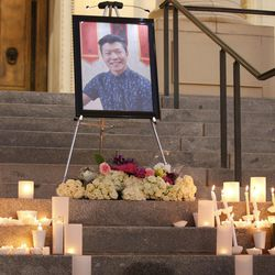 Candles are left by a photo of ChenWei Guo on the steps of the Park Building during a candlelight vigil at the University of Utah in Salt Lake City on Wednesday, Nov. 1, 2017. Guo who was shot and killed during a car jacking.